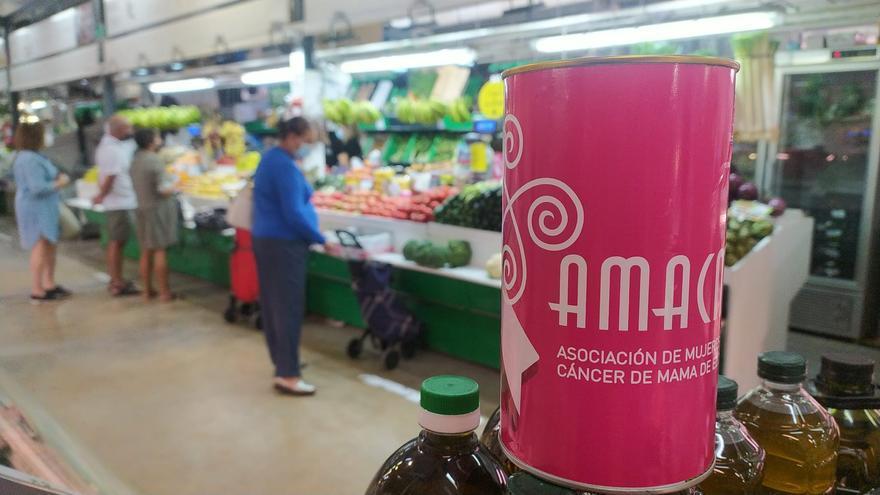 El Mercado Central de Elche se llena de huchas rosas