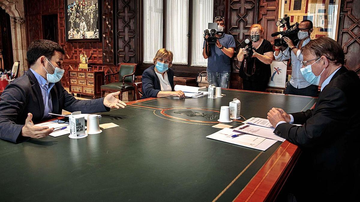 Los conselleres Marzà Y Barceló con el presidente Puig en una reunión celebrada en agosto