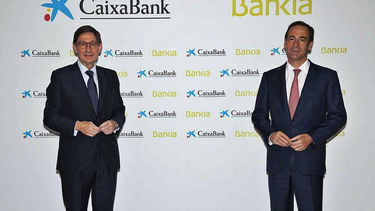Goirigolzarri, presidente de Bankia, y Gortázar, consejero delegado de CaixaBank.