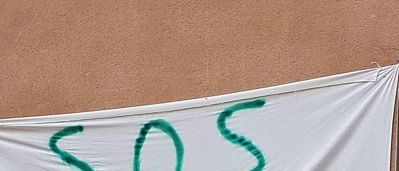 Pancarta de los vecinos.