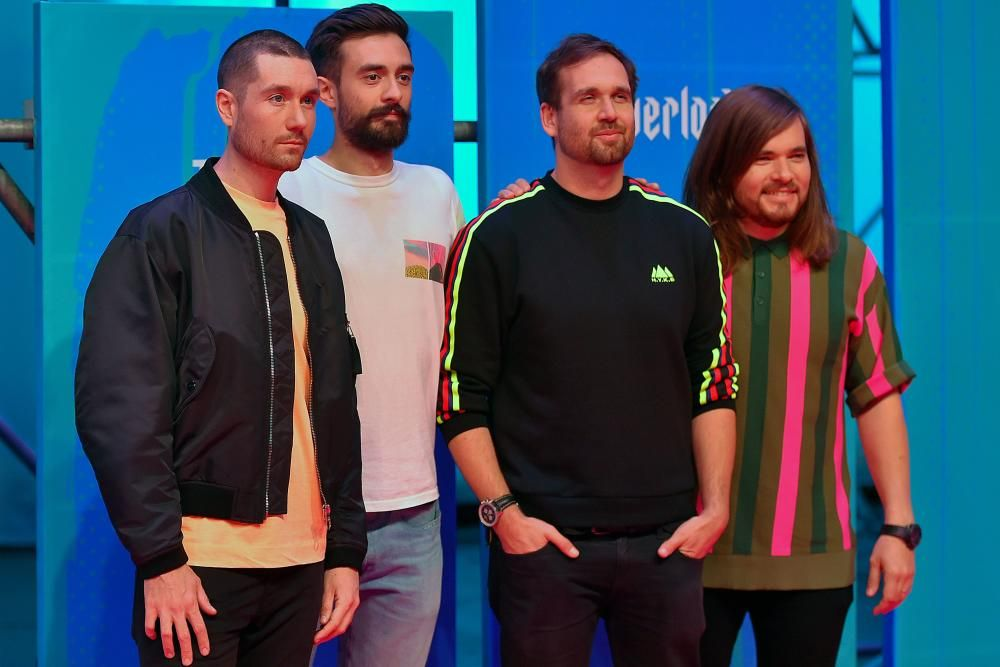 British band Bastille pose on the red carpet ahead of the MTV Europe Music Awards at the Bizkaia Arena in the northern Spanish city of Bilbao on November 4, 2018. (Photo by ANDER GILLENEA / AFP)