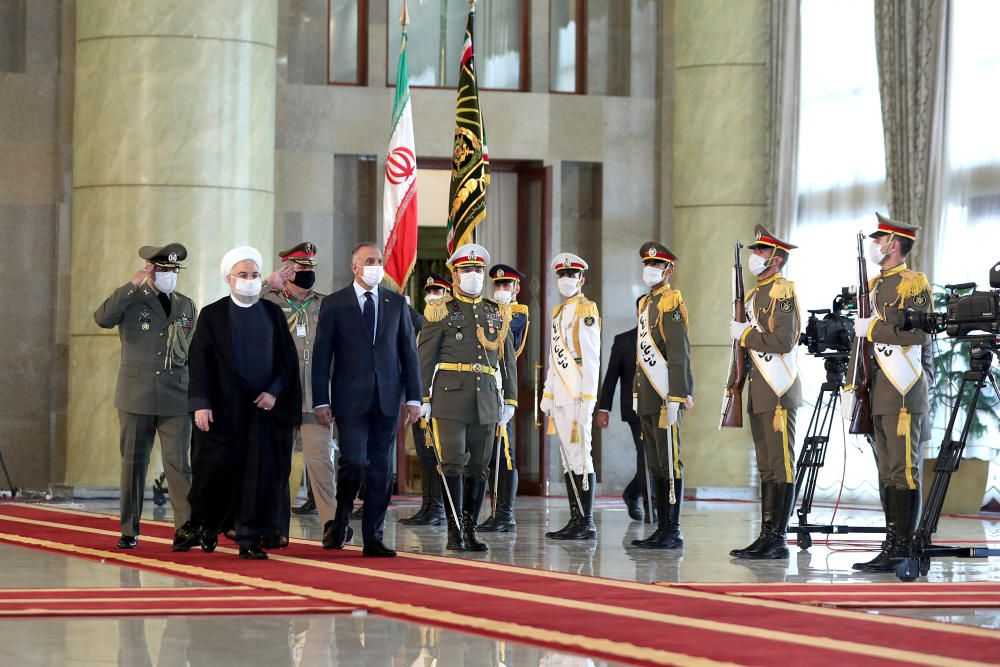 Iranian President Hassan Rouhani and Iraqi Prime ...