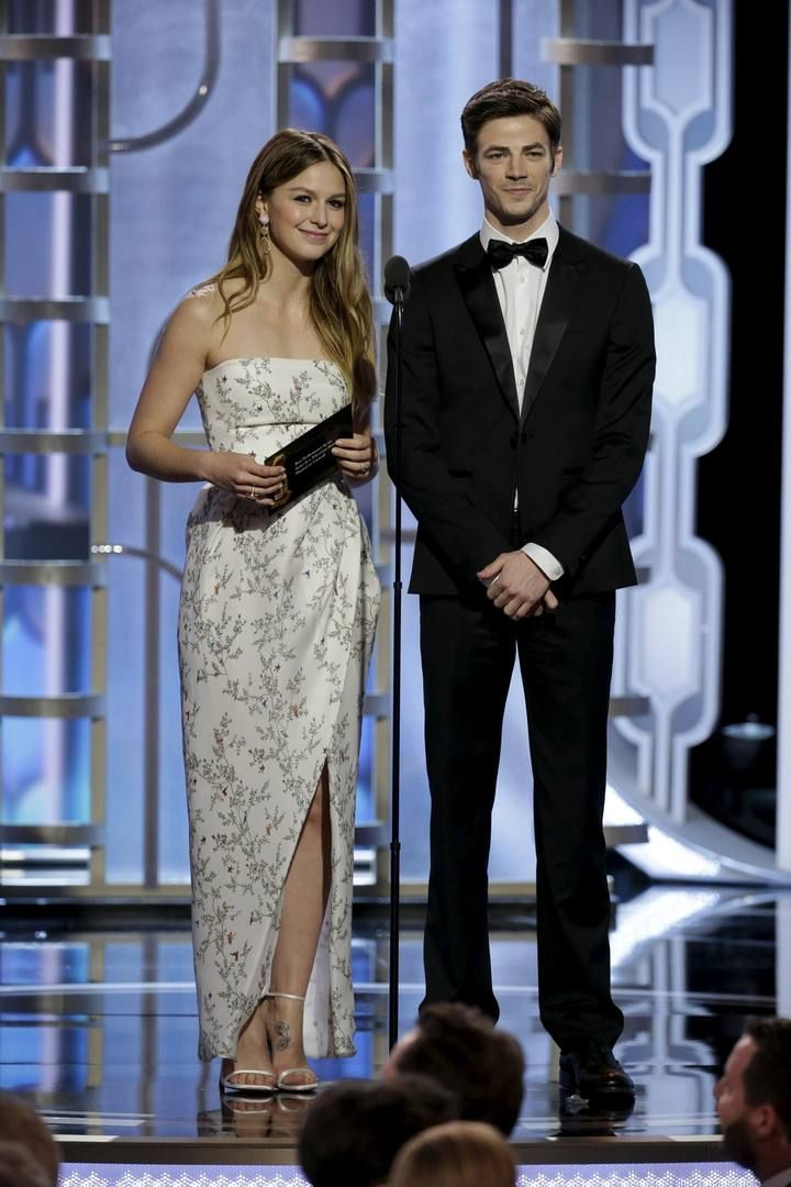 Handout photo of Melissa Benoist and Grant Gustin presenting at the 73rd Golden Globe Awards in Beverly Hills