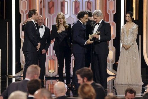 "Ford presents a Golden Globe to Director Alejandro G. Inarritu after ""The Revenant"" won Best Motion Picture, Drama, at the 73rd Golden Globe Awards in Beverly Hills"