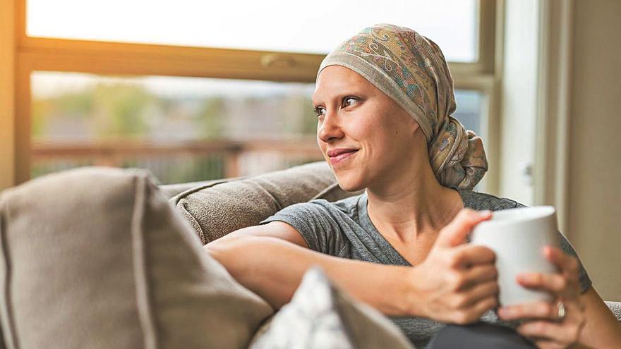 CaixaBank y la AECC promueven una campaña de donativos a favor de la investigación contra el cáncer