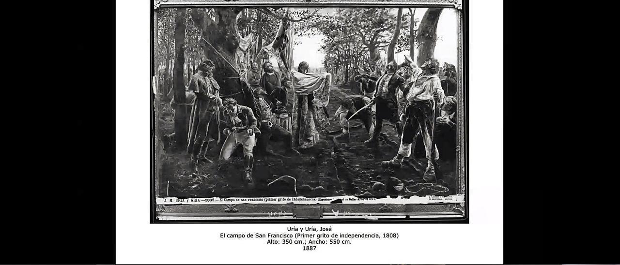 """Un momento de la ponencia de Javier Barón, con la proyección de una fotografía del cuadro """"El campo de San Francisco (Primer grito de Independencia, 1808)"""", de José Uría y Uría, que se custodiaba en la Universidad de Oviedo y fue destruido en 1934."""