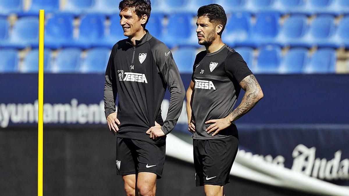 Scepovic y Caye, durante un entrenamiento a lo largo del pasado curso en La Rosaleda.