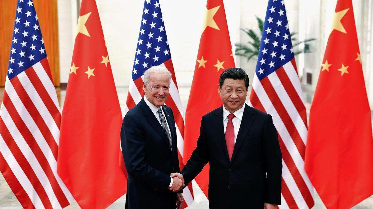 Biden y Xi, en una cumbre de 2013, cuando el primero era vicepresidente de EE UU.