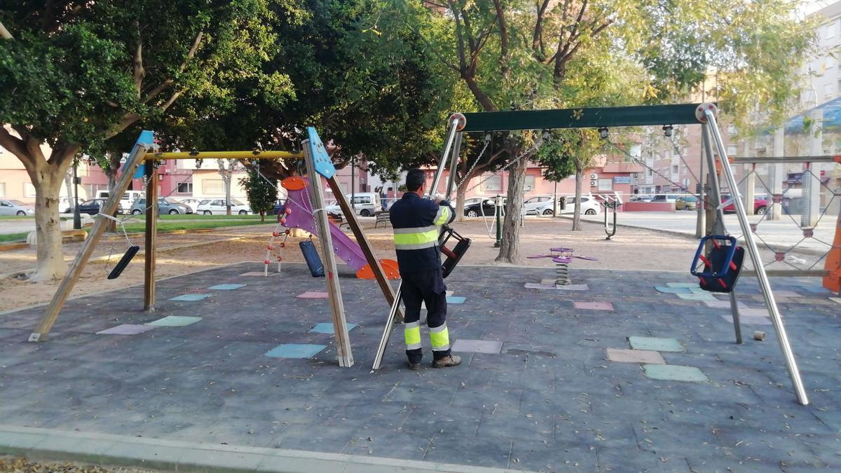 A municipal worker in a playground in Orihuela