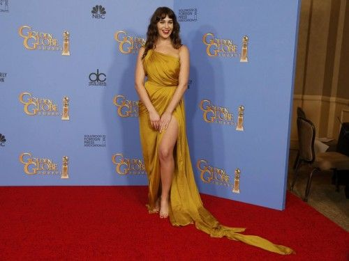 Actress Lola Kirke poses backstage at the 73rd Golden Globe Awards in Beverly Hills