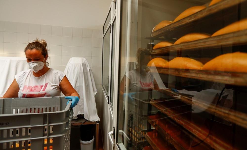 Daura Vega works in her bakery, as the country ...
