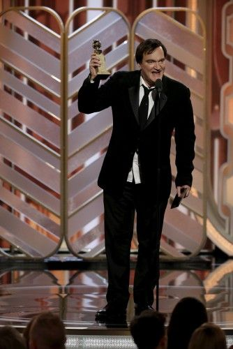 "Handout of Tarantino accepting the award for Morricone after ""The Hateful Eight"" won Best Original Score - Motion Picture at the 73rd Golden Globe Awards in Beverly Hills"