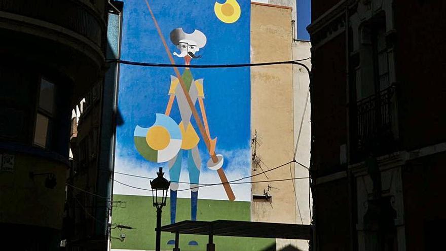 Mural pintado en la pared de un edificio colindante con el solar de la antigua librería Belter en Sama. | Irma Collín
