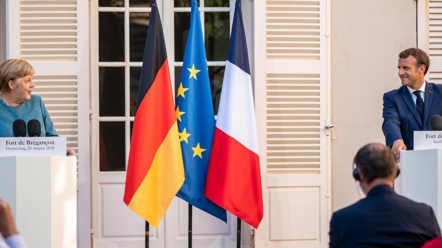 Macron y Merkel piden más coordinación europea en la lucha contra la COVID-19