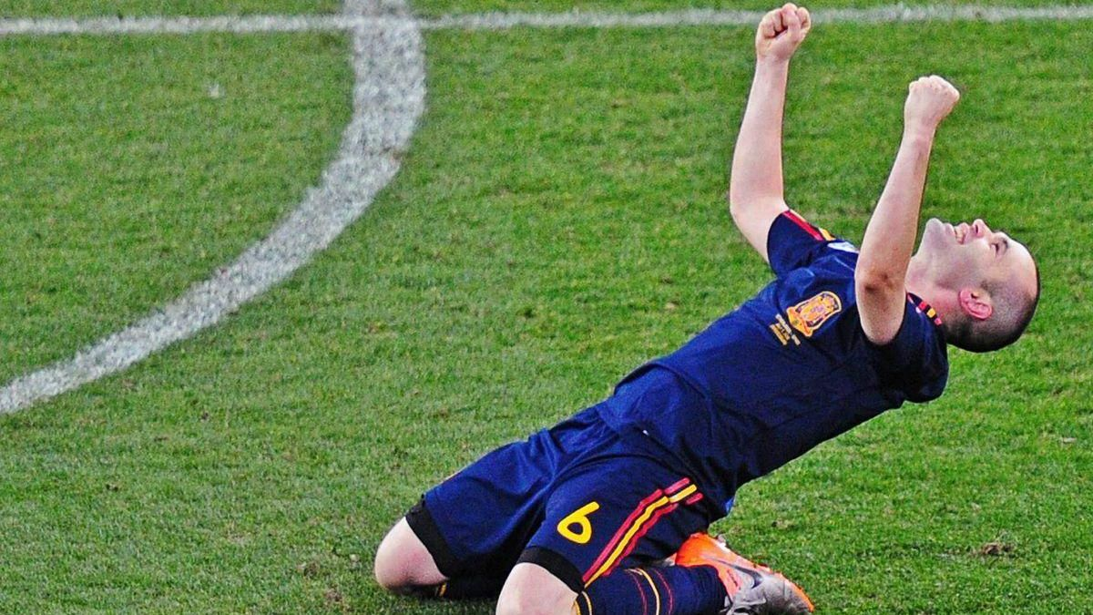 Spain's midfielder Andrés Iniesta celebrates at the end of the 2010 football World Cup final between the Netherlands and Spain on July 11, 2010 at Soccer City stadium in Soweto, suburban Johannesburg. NO PUSH TO MOBILE / MOBILE USE SOLELY WITHIN EDITORIAL ARTICLE - AFP PHOTO / FRANCK FIFE