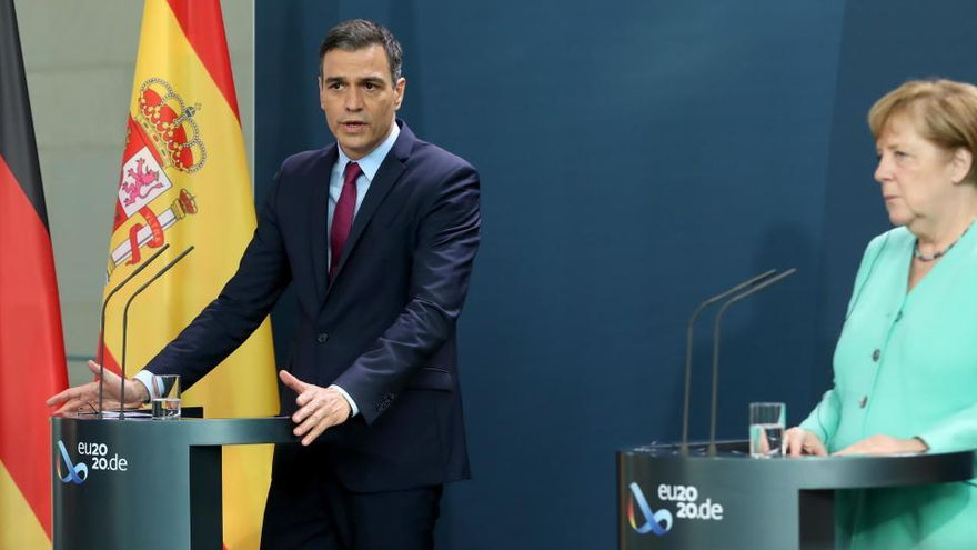 Angela Merkel, junto al presidente Pedro Sánchez.