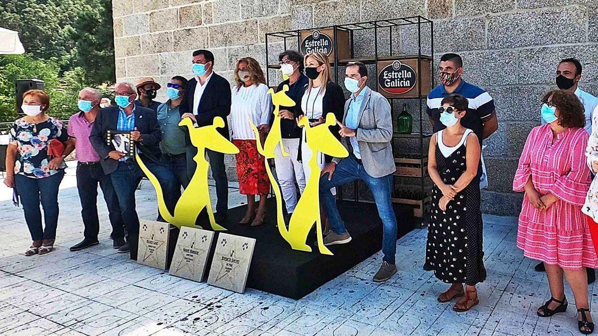 Asistentes a la presentación del Festival de Cans, con mascarillas.