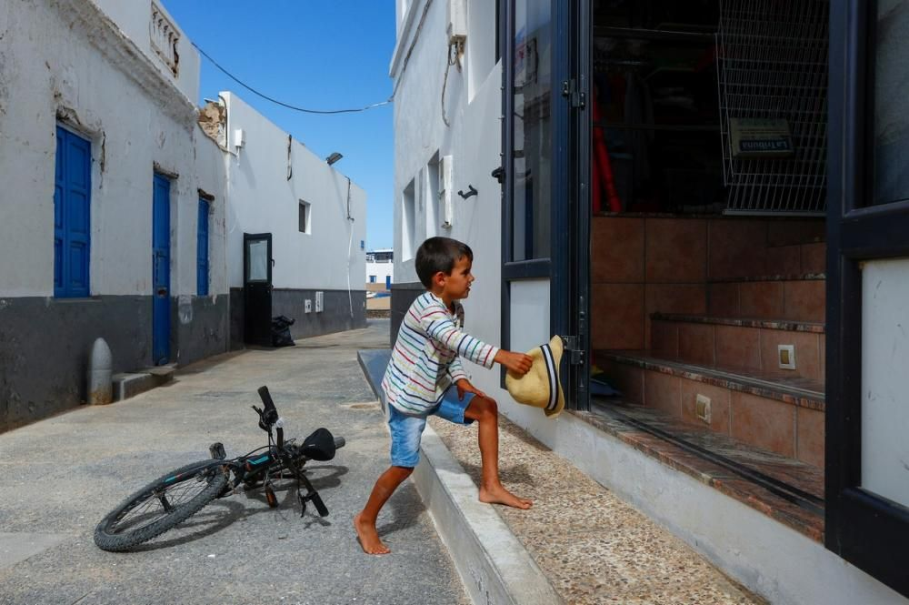 A child enters a store, as the country relaxes ...