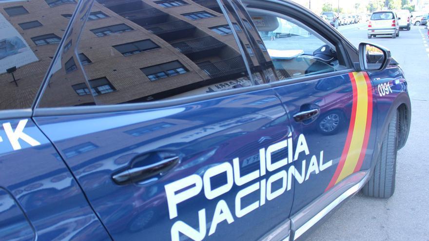 La Policía Nacional detiene a dos menores por quemar un contenedor en Russafa