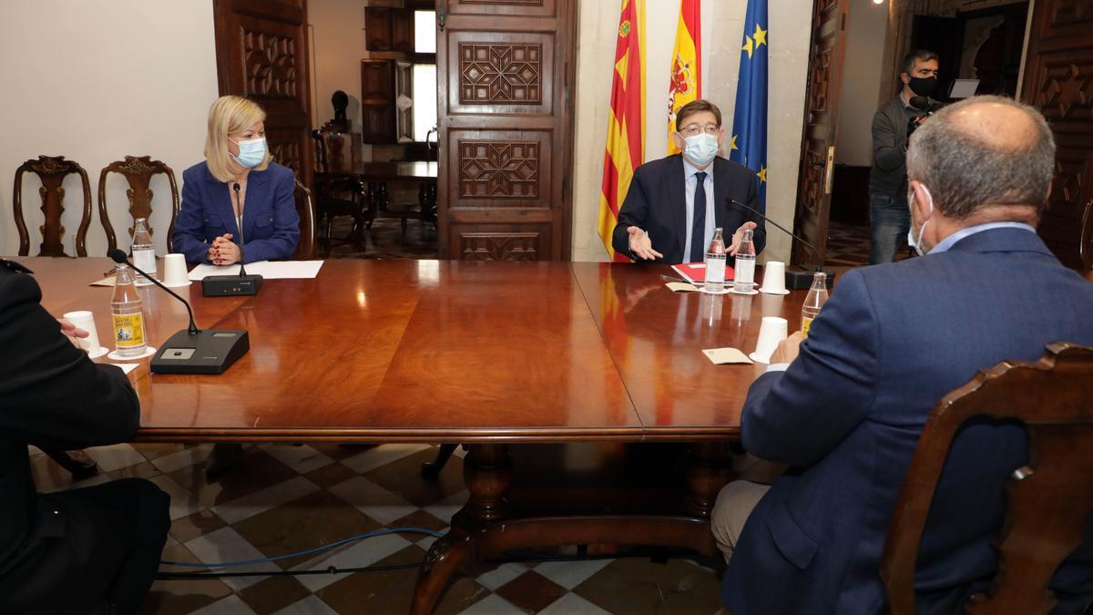 El president Puig y la consellera Bravo, en la reunión para planificar la seguridad en Semana Santa