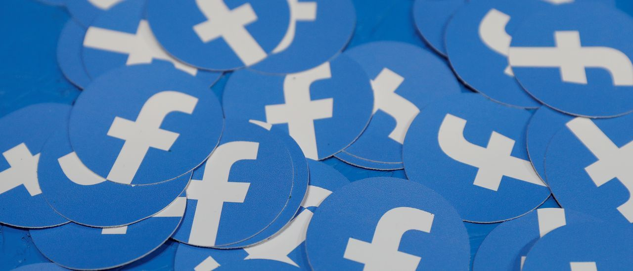 FILE PHOTO: Stickers bearing the Facebook logo are pictured at Facebook Inc's F8 developers conference in San Jose