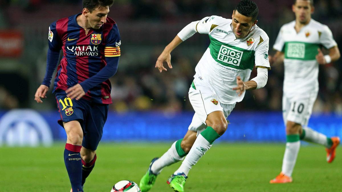 Messi, junto a Fayçal, en la última visita del Elche en Liga al Camp Nou el 5 de enero de 2014