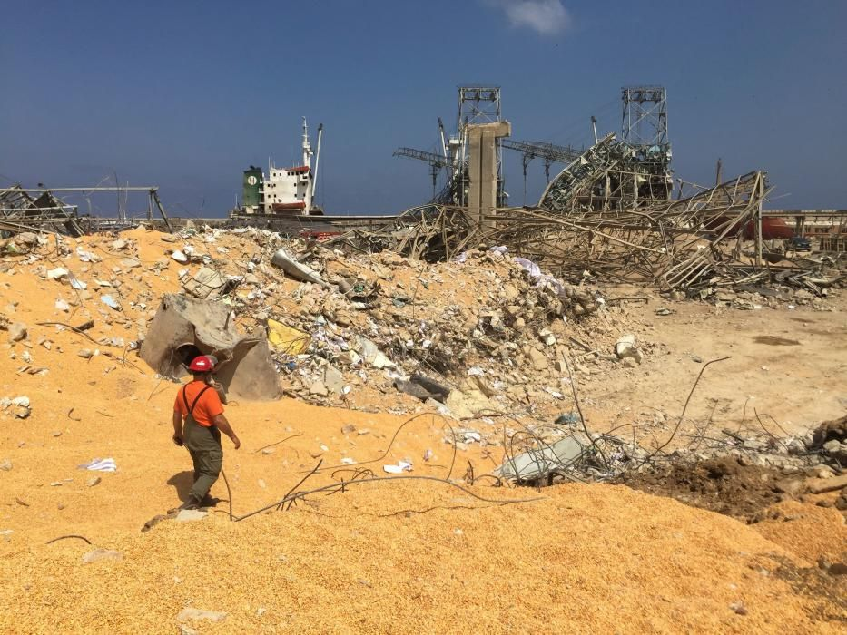 A man walks near rubble at the site of Tuesday's ...