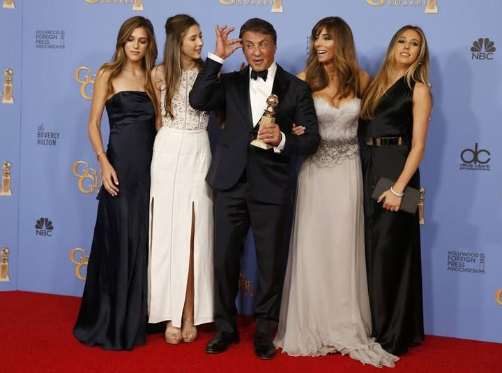 "Sylvester Stallone and his family pose with his award for Best Performance by an Actor in a Supporting Role in any Motion Picture for his role in ""Creed"" backstage at the 73rd Golden Globe Awards in Beverly Hills"