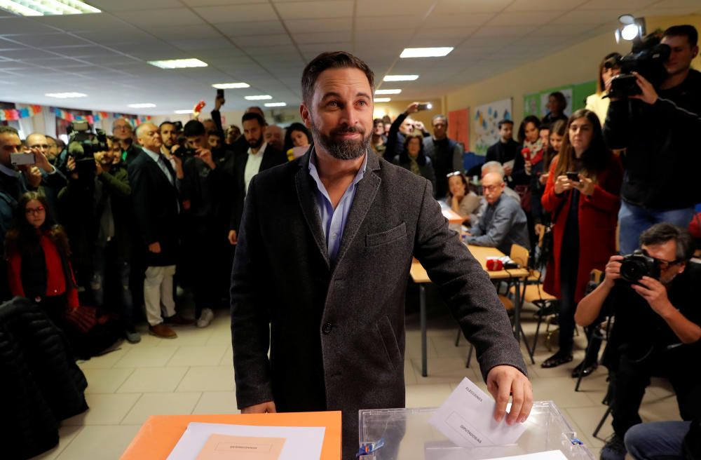Vox party candidate Santiago Abascal votes in ...