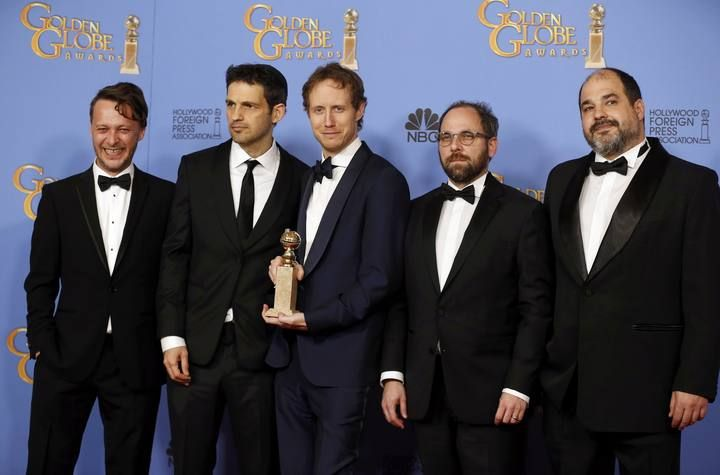 Laszlo Nemes poses with his award during the 73rd Golden Globe Awards in Beverly Hills