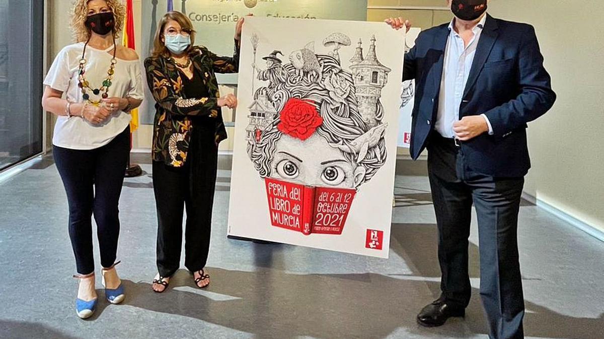 La consejera y Asensio Piqueres, presidente de Palin, sujetan el cartel de la Feria del Libro. | CARM