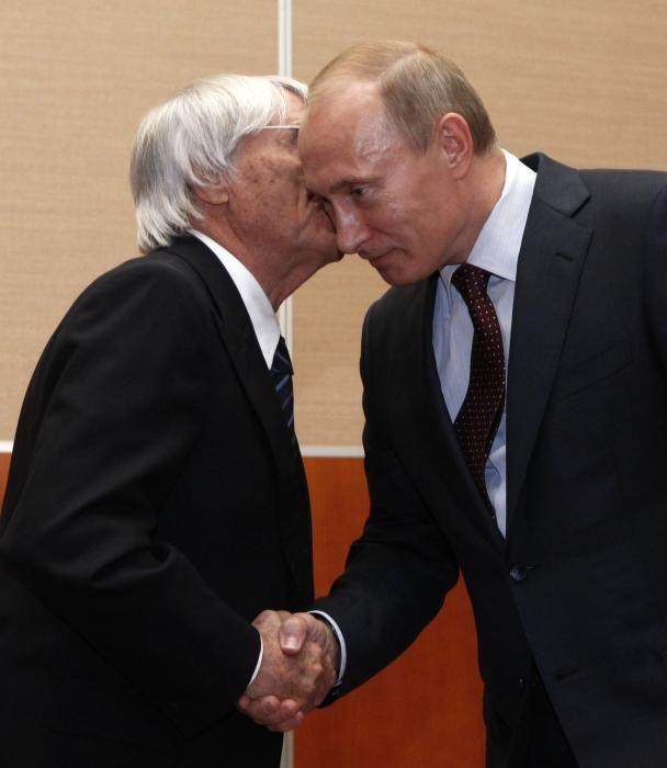 Russia's Prime Minister Putin shakes hands with ...
