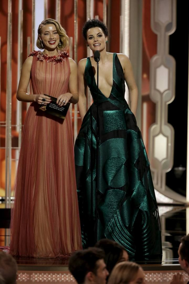 Handout of Heard and Alexander presenting at the 73rd Golden Globe Awards in Beverly Hills