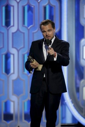 "Handout photo of Leonardo DiCaprio holding his award for Best Actor, Motion Picture, Drama, for ""The Revenant"" at the 73rd Golden Globe Awards in Beverly Hills"