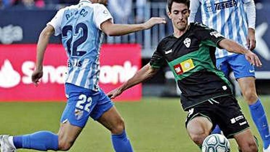 El Oviedo cae en Las Palmas y el Málaga salva un punto ante el Elche