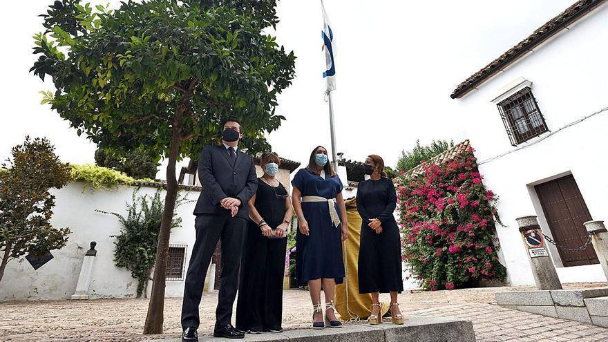 Izado de bandera en el Arqueológico por el Día de las Ciudades Patrimonio