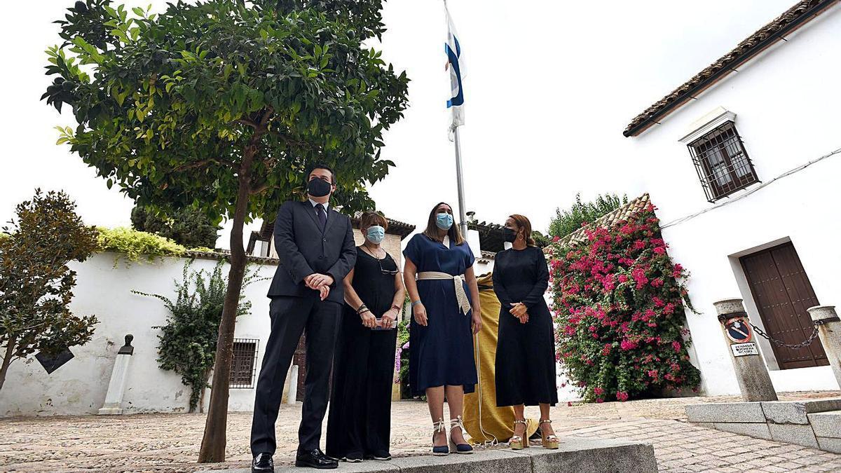 Izado de bandera en el Arqueológico por el Día de las Ciudades Patrimonio.