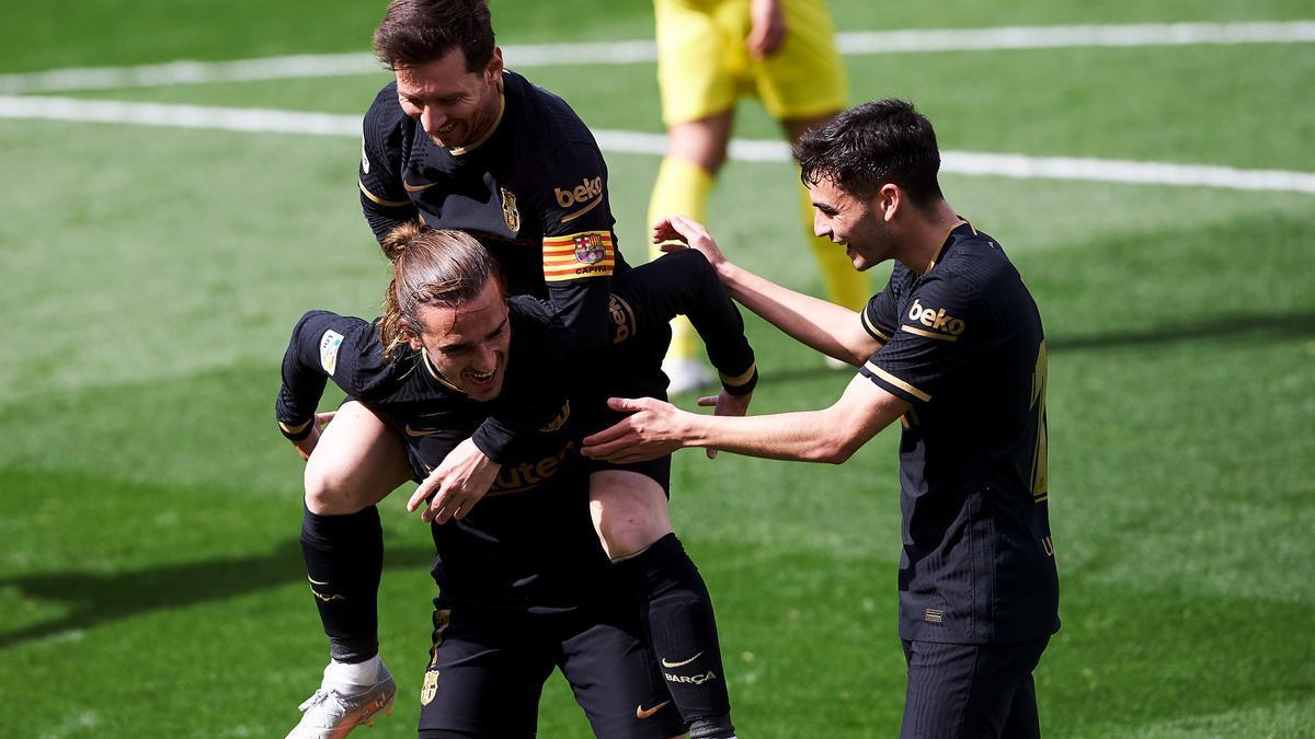 Messi y Griezmann celebran uno de los goles del francés.