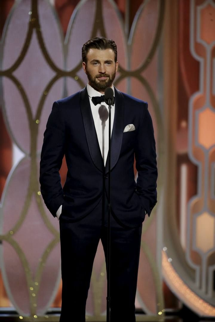 Evans presents at the 73rd Golden Globe Awards in Beverly Hills, California