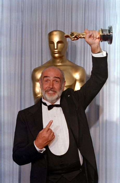 FILE PHOTO: Actor Sean Connery holds up his ...