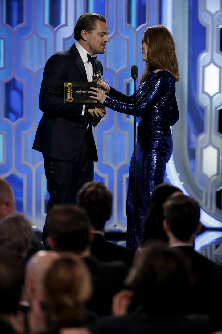 Handout photo of Julianne Moore presenting the Golden Globe to Leonardo DiCaprio  at the 73rd Golden Globe Awards in Beverly Hills