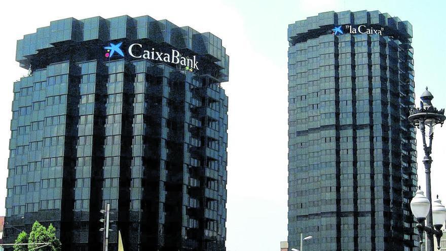 Calviño y Fainé impulsan la unión de CaixaBank y Bankia
