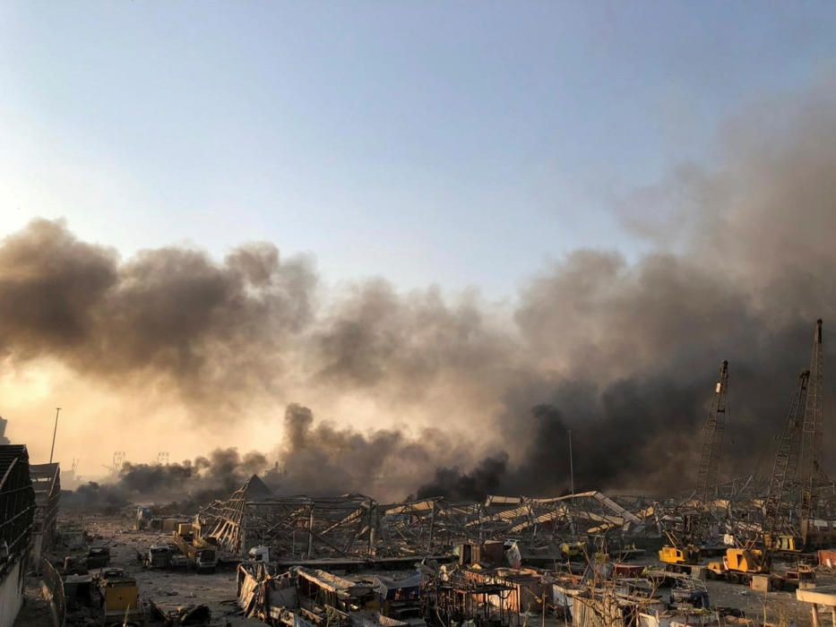 Smoke rises after an explosion was heard in Beirut