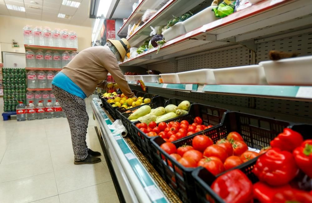 A woman is seen at a supermarket, on the first ...