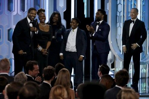 Washington and his family react on stage after Washington wins the Cecil B. Demille Award at the 73rd Golden Globe Awards in Beverly Hills