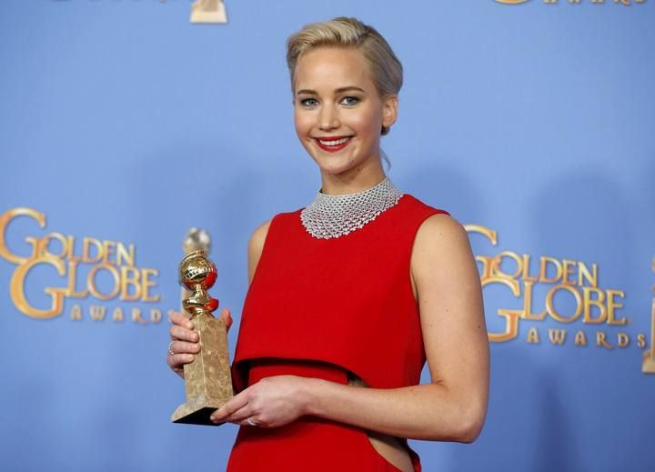 "Jennifer Lawrence poses backstage with the award for Best Performance by an Actress in a Motion Picture - Musical or Comedy for her role in ""Joy"" at the 73rd Golden Globe Awards in Beverly Hills"