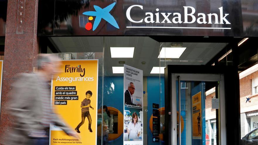 CaixaBank y Bankia llegan a la fusión con una mora a años luz de la crisis de 2012