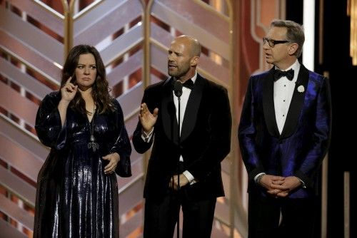 McCarthy, Jason Statham and Feig are seen on stage at the 73rd Golden Globe Awards in Beverly Hills