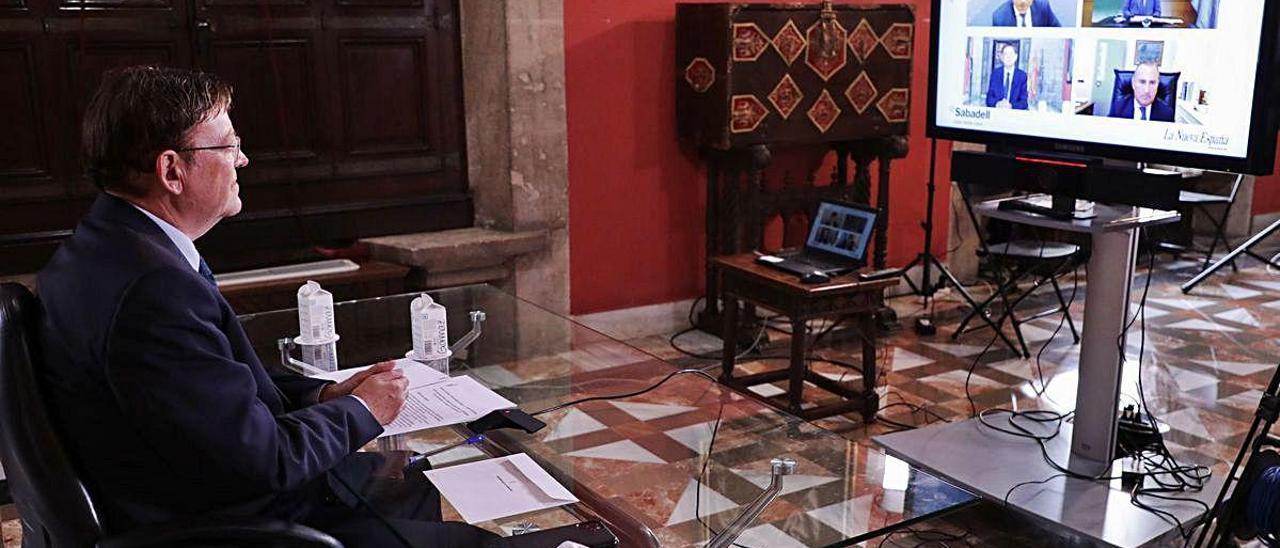 Puig, ayer, durante el encuentro telemático con el presidente de Asturias.