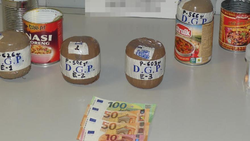 Detenido en el Reina Sofía con heroína y éxtasis escondidos en latas de comida